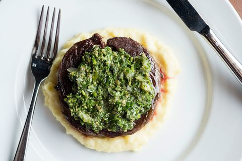 The dainty-looking Bowery steak, a rolled-up ribeye cap on mashed potato with salsa verde.