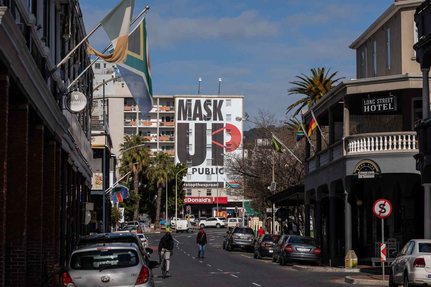 A 'mask up' billboard covers the front of a buildingin Cape Town on Aug. 19.