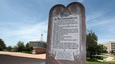 In this June 20, 2014, file photo, shows the Ten Commandments monument at the state Capitol in Oklahoma City.