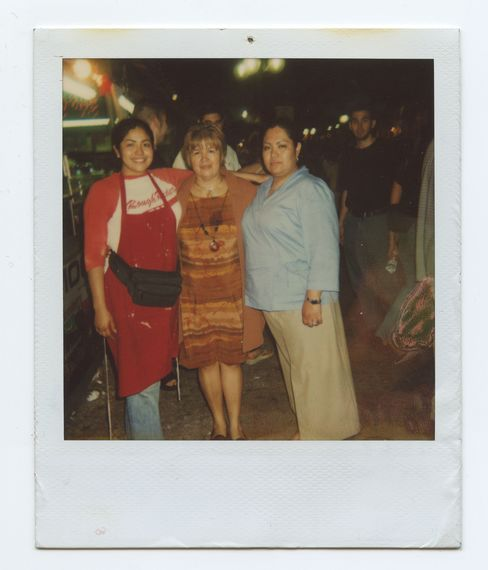 In 2001, with her mom and sister in front of the family's funnel cake cart in San Antonio.