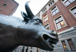 A bull statue stands outside Amsterdam Stock Exchange, operated by Euronext NV, in Amsterdam, Netherlands.