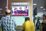 People watch a television screen showing an image of Kim Jong Un, leader of North Korea, center, during a news broadcast on North Korea's nuclear test at Seoul Station in Seoul, South Korea, on Sunday, Sept. 3, 2017.