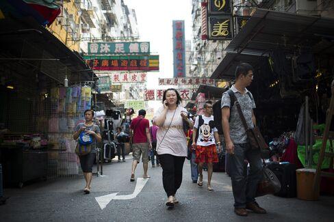 Leung Raises Spending on Poor as Hong Kong Economy Shows Pickup