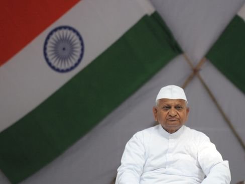 Singh Faces Protests by Campaigner Hazare on Graft Law