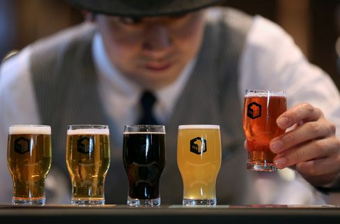 A bartender arranges glasses of craft beer for a photograph at a Spring Valley Brewery brewpub in Yokohama, on march 35, 2015.  Photographer: Yuriko Nakao/Bloomberg