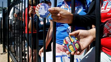 Supporters of Democratic presidential candidate Hillary Clinton hold campaign buttons on March 21, 2016, in Phoenix.