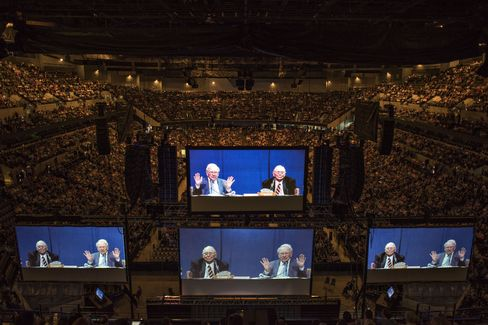 Buffett and Munger appear on screens in Omaha, on May 2, 2015.