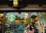 Customers at a Shanghai Starbucks on Feb. 24, 2018.