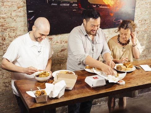 David Chang (center) and J.J. Basil (left) fill Kate Krader's plate with delights from Ando.