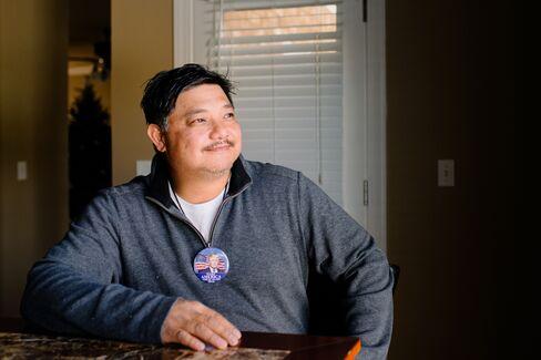 Ish Yniesta sits inside his new home in South Carolina.