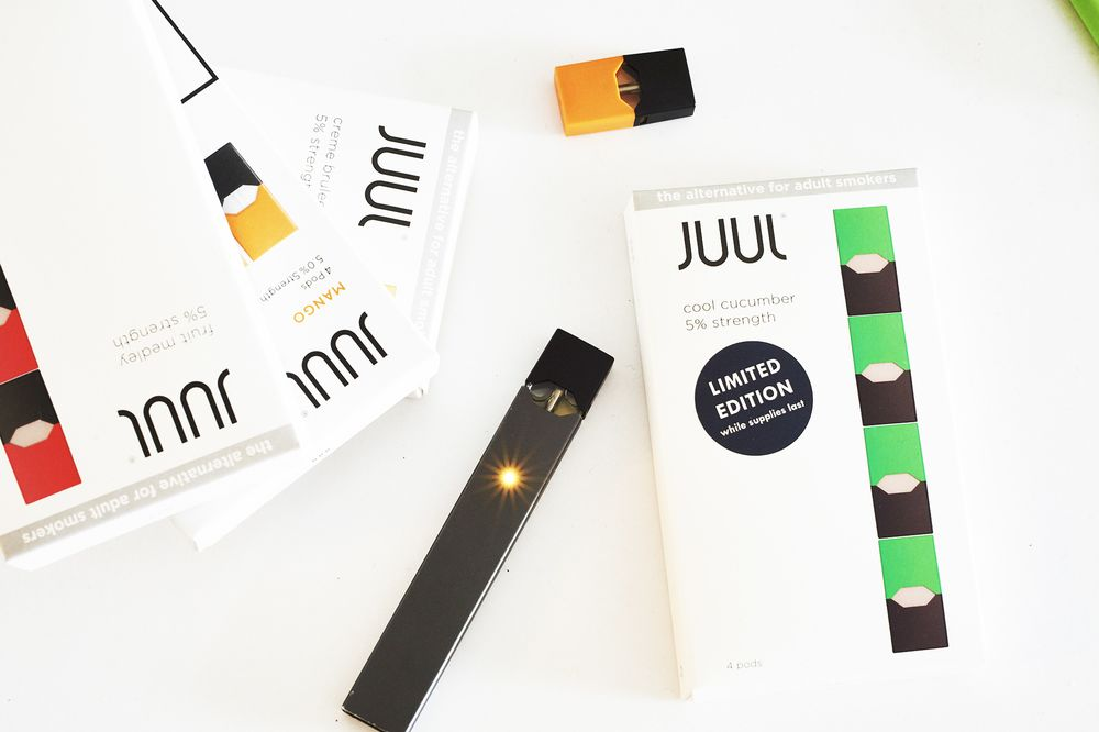 A Juul e-cigarette and a USB charger.