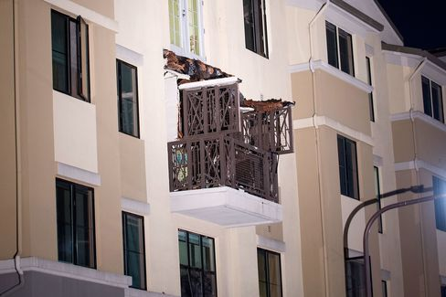 A fourth floor balcony rests on the balcony below after collapsing at the Library Gardens apartment complex in Berkeley, California on June 16, 2015.
