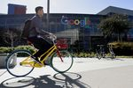 A cyclist rides a bicycle inside the Googleplex headquarters in Mountain View, California. Photographer: Michael Short/Bloomberg