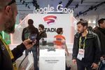 Attendees look at the Google Inc. Stadia game controller at the Game Developers Conference in San Francisco, California.