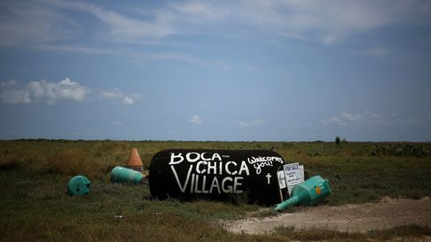 A repurposed buoy acts as a welcome sign to the village of Boca Chica