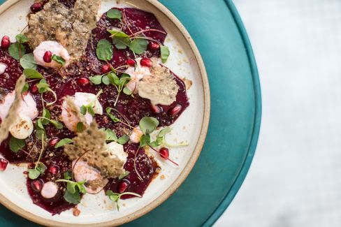 Beetroot carpaccio features goat's cheese, hazelnuts, and date-and-honey syrup.