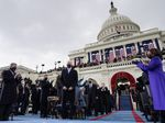 US Vice President-elect Kamala Harris (R) applauds as US President-elect Joe Biden (C) arrives for his inauguration as the 46th US President, on the West Front of the US Capitol in Washington, DC on January 20, 2021.