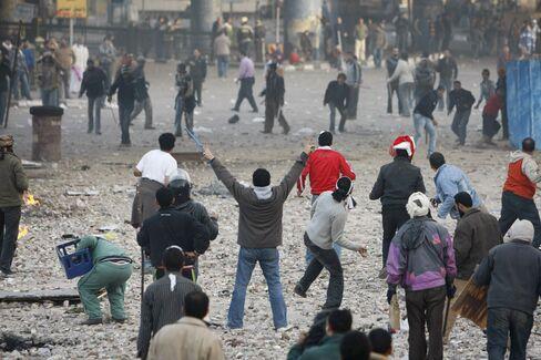 Mubarak Allies Battle Protesters