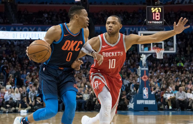 russell westbrook 0 of the oklahoma city thunder works his way around eric gordon 10 of the houston rocketsduring the first half of a nba game at the - Nba Christmas Day