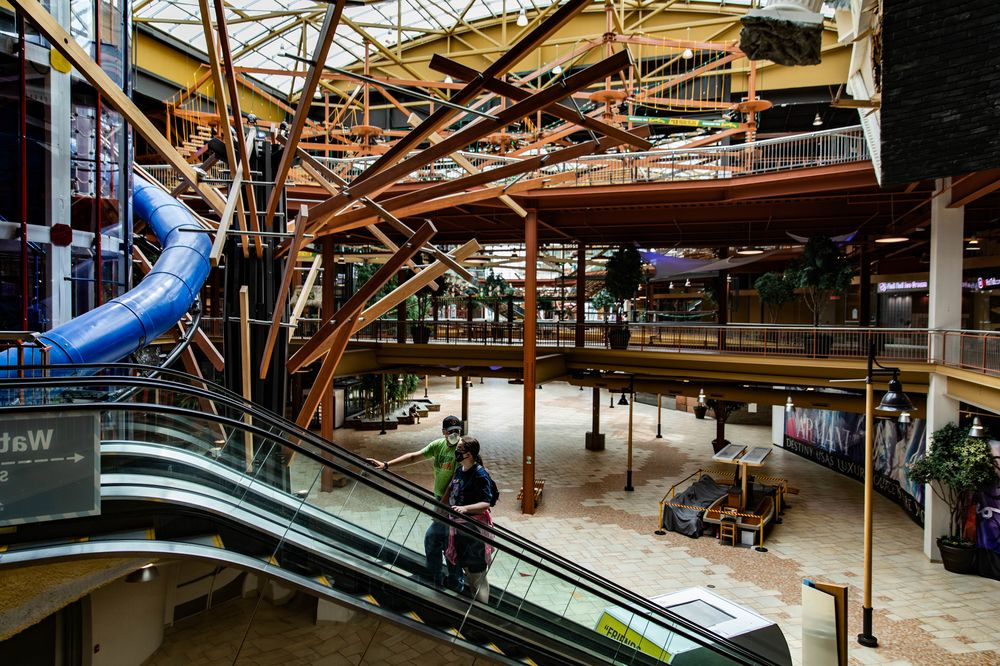 Shoppers walk through the Destiny USA mall in Syracuse, New York, on July 10, 2020.