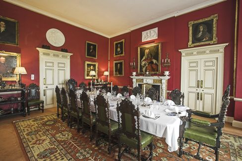 Here, the dining room. Those 19th century Jacobean dining chairs are for sale, too, in a set of 16.