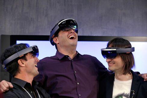 Microsoft's Joe Belfiore, left, Terry Myerson and Alex Kipman wear