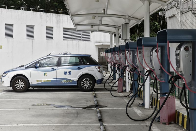 A BYD Co. E6 electric taxi is charged at the company's charging station in Shenzhen, China.