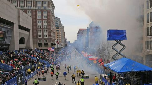 Emergency personnel respond to the scene after two explosions went off near the finish line of the 117th Boston Marathon on April 15, 2013.