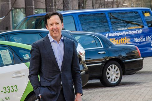 Mark Joseph, CEO of Transdev North America, with vehicles representing the On Demand division of the company, including taxi, ExecuCar, and SuperShuttle.