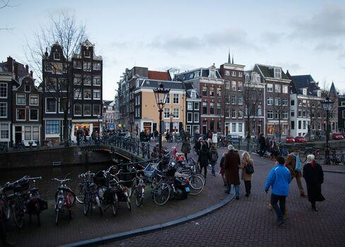 Pedestrians Walk Over a Bridge in Amsterdam