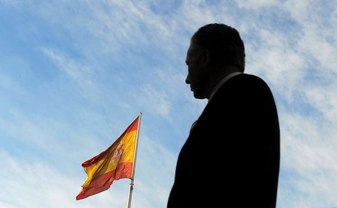 Spain Downgraded to BBB as Fitch Forecasts Slump Through 2013