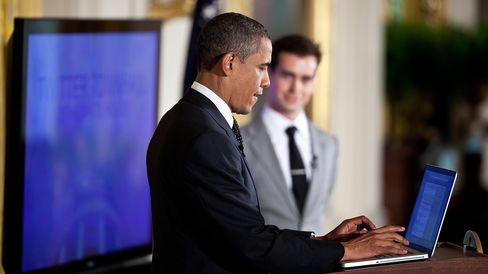 U.S. President Barack Obama posts a Tweet during an online Twitter town hall meeting from the East Room of the White House July 6, 2011 in Washington, DC.