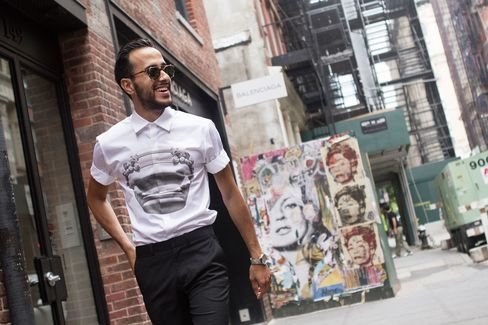 Moti walks through SoHo between shows and stops by the Mercer Hotel in a shirt by Neil Barrett and trousers by Theory.