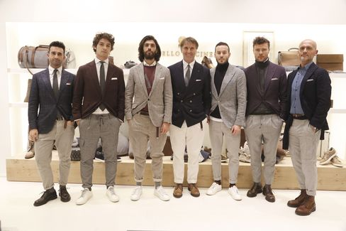 Italian designer Brunello Cucinelli, seen here with his brand ambassadors at his booth at Pitti, has a namesake line that is often considered one of the most aspirational aesthetics in menswear.