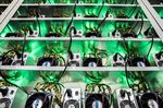 Cryptocurrency mining rigs composed of Antminer S9 ASIC machines operate on racks at the HydroMiner GmbH cryptocurrency mining facility near Waidhofen an der Ybbs, Austria.