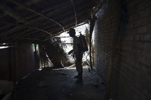 A worker sprays dichlorodiphenyltrichloroethane (DDT) as part of a Government of Bihar initiative to eradicate Black Fever in Raghopur, Bihar. Photographer: Prashanth Vishwanathan/Bloomberg