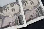 Japanese Yen and U.S. Dollar Banknotes Ahead of US-Japan Trade Talks