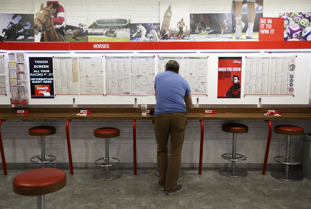 Online betting on horses at ladbrokes plc booking points football betting