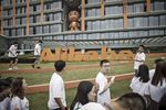 Employees and visitors walk past signage for Alibaba Group Holding Ltd. at the company\'s headquarters in Hangzhou, China.