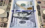 General Images Of Japanese Yen and US Dollars As Yen Extended Gains Against Dollar