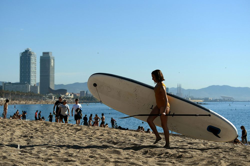 spain opens beaches and eases rules in madrid barcelona bloomberg spain opens beaches and eases rules in