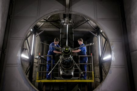 Technicians work on an M601 turboprop aircraft engine at the GE Aviation Czech plant in Prague.