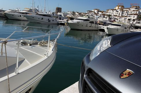 Luxury yachts float in Puerto Banus, Marbella's marina and luxury shopping district