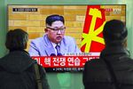 People watch a television news broadcast showing North Korean leader Kim Jong-Un's New Year's speech, at a railway station in Seoul on January 1, 2018.