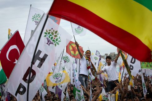 Supporters of the Peoples' Democratic Party, also known as HDP, wave flags during a pre election rally with a speech by party leader Selahattin Demirta