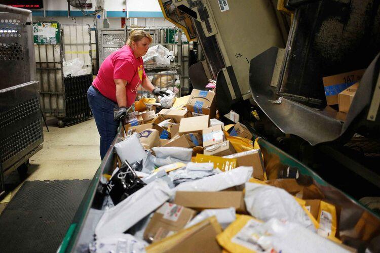 Inside aU.S. Postal Service sorting facility.