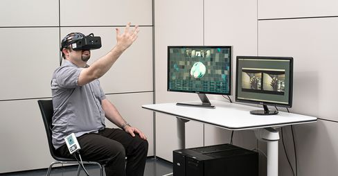 A motion-sensing camera projects a patient's avatar onto its VR goggles or a PC screen. Through as many as 32 electrodes placed on his head, the patient can command his virtual arm to lift a glass or his virtual leg to kick.
