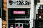 T-Mobile US Inc. signage is displayed on the exterior of a store location in New York, U.S.