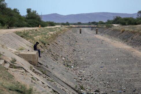 A dried-up irrigation canal near the Mundargi industrial parkin Ballari, India, on May 17, 2016.