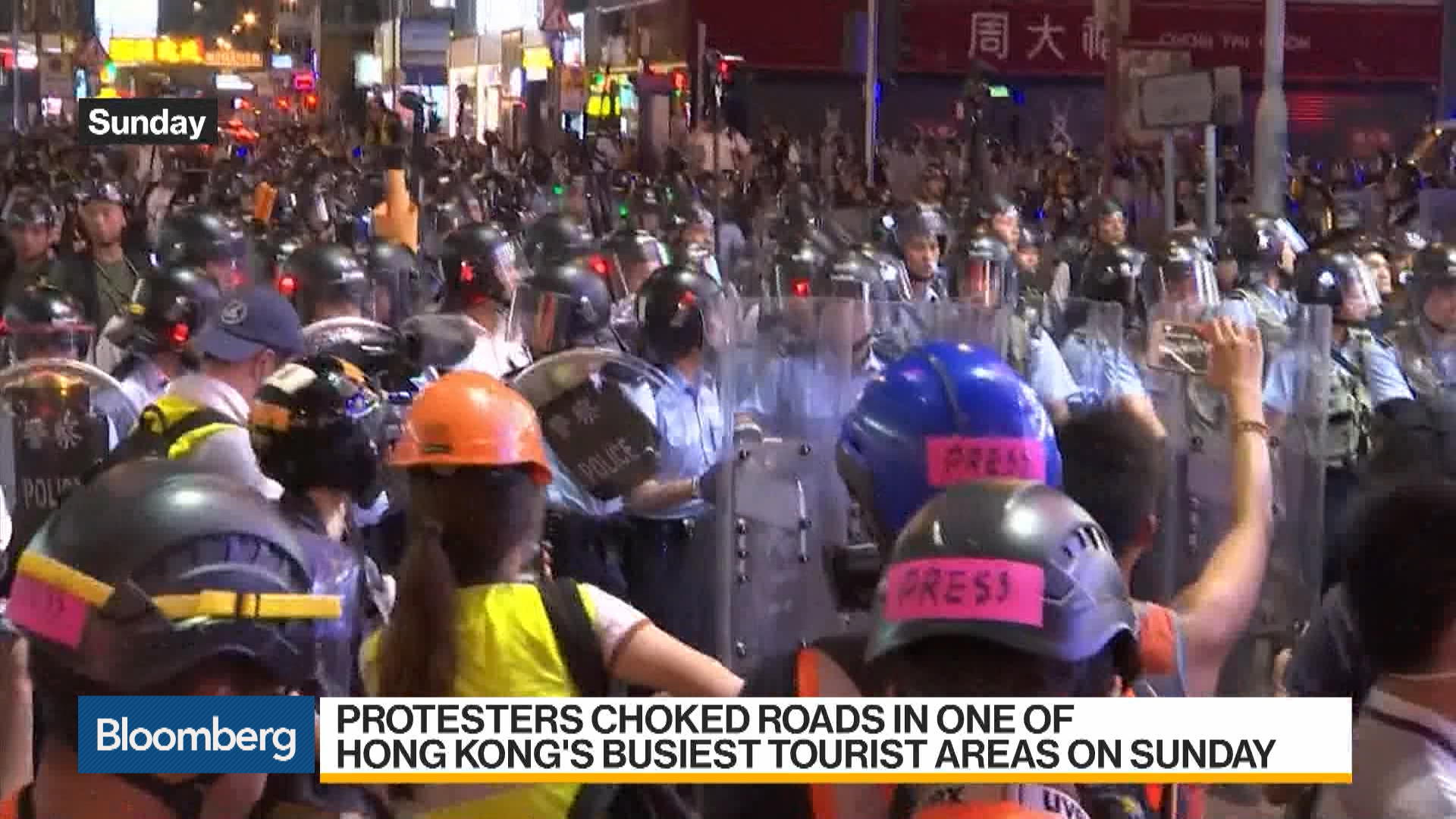 Hong Kong Protesters Choke Roads in Tourist District